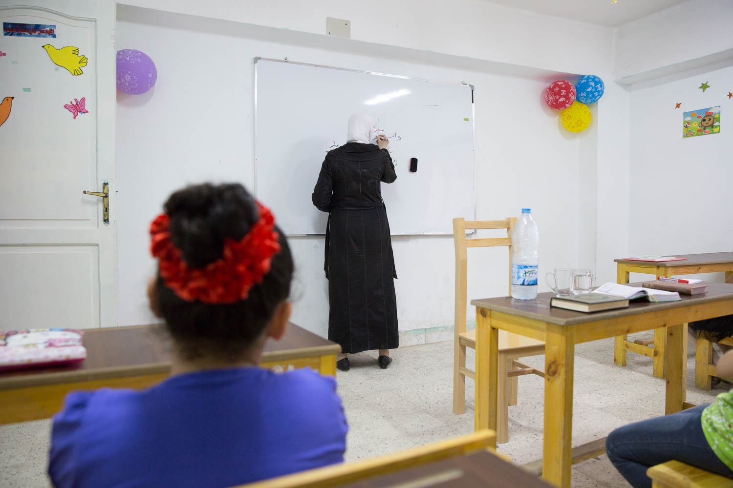 Fatma, has lived in Egypt for 2 years after fleeing her homeland of Syria. She now teaches after-school religious classes at Ansan's community center in Greater Cairo. Ansan (Human in English) is a partner organisation of Plan International Egypt.