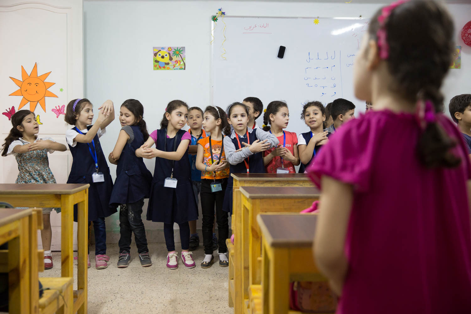 Children perform a dance during remedial classes offered by NGO Ansan and Plan International.