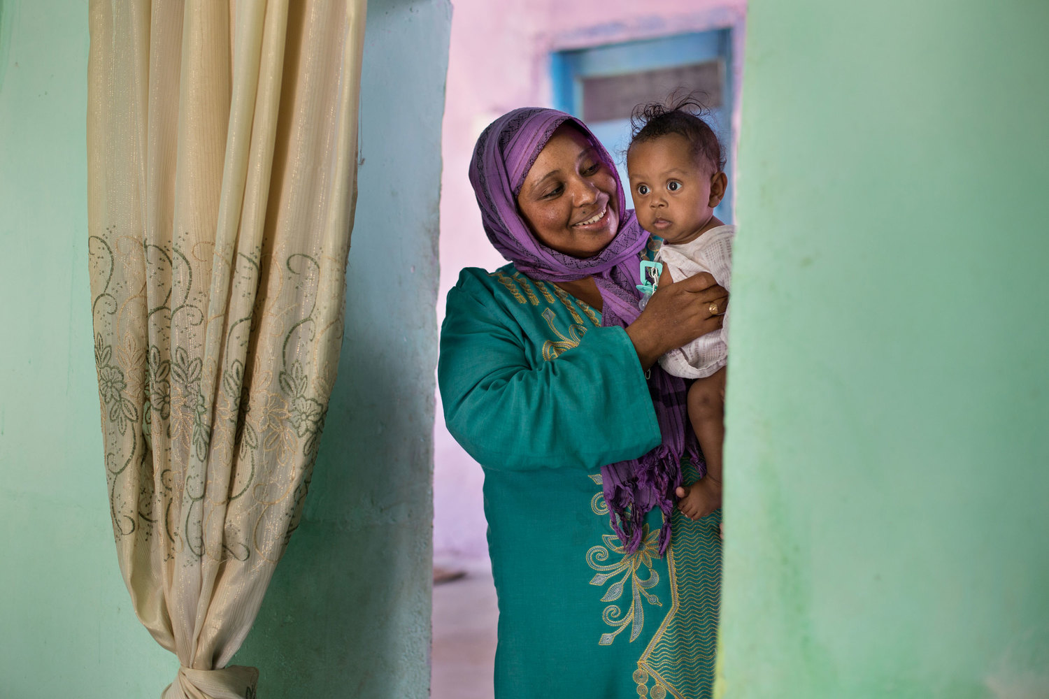 On Heisa Island, Sabreen holds her 6-month old son Mohammed.