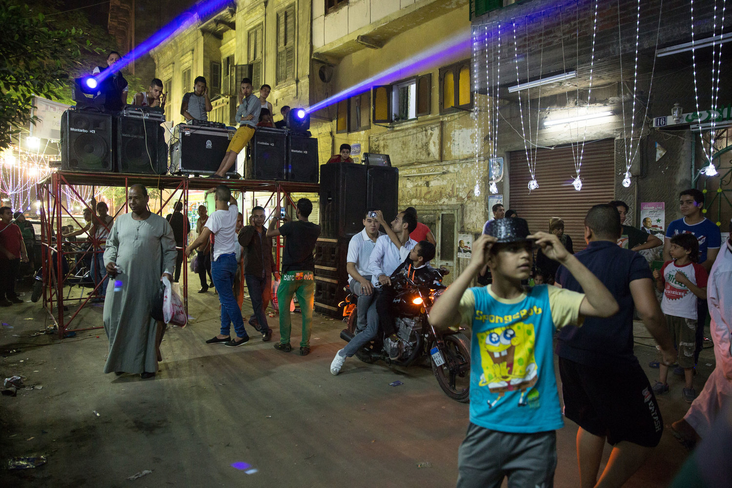 In a side street, local youth organized an electro-sha'abi dance party.  While the main streets are filled with the festival, the locals often stay in side streets at their own gatherings.