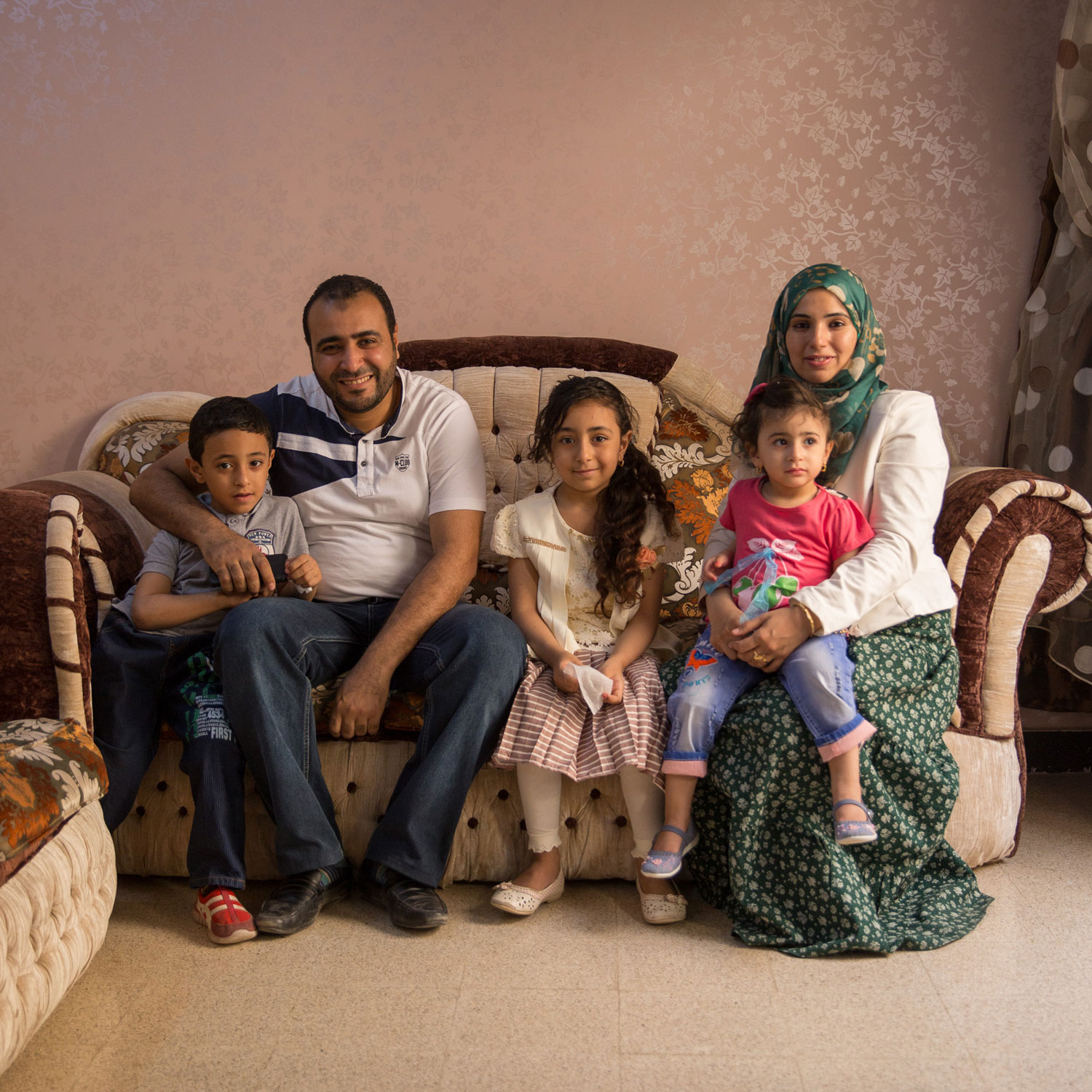 "Heba and her husband Amr live in Al Quseya together with their three children.  Amr shares ""I wanted to study engineering but I couldn't, so I fully support her career. Her success is our success as she is an extension of myself.""   Photo for USAID/Egypt."